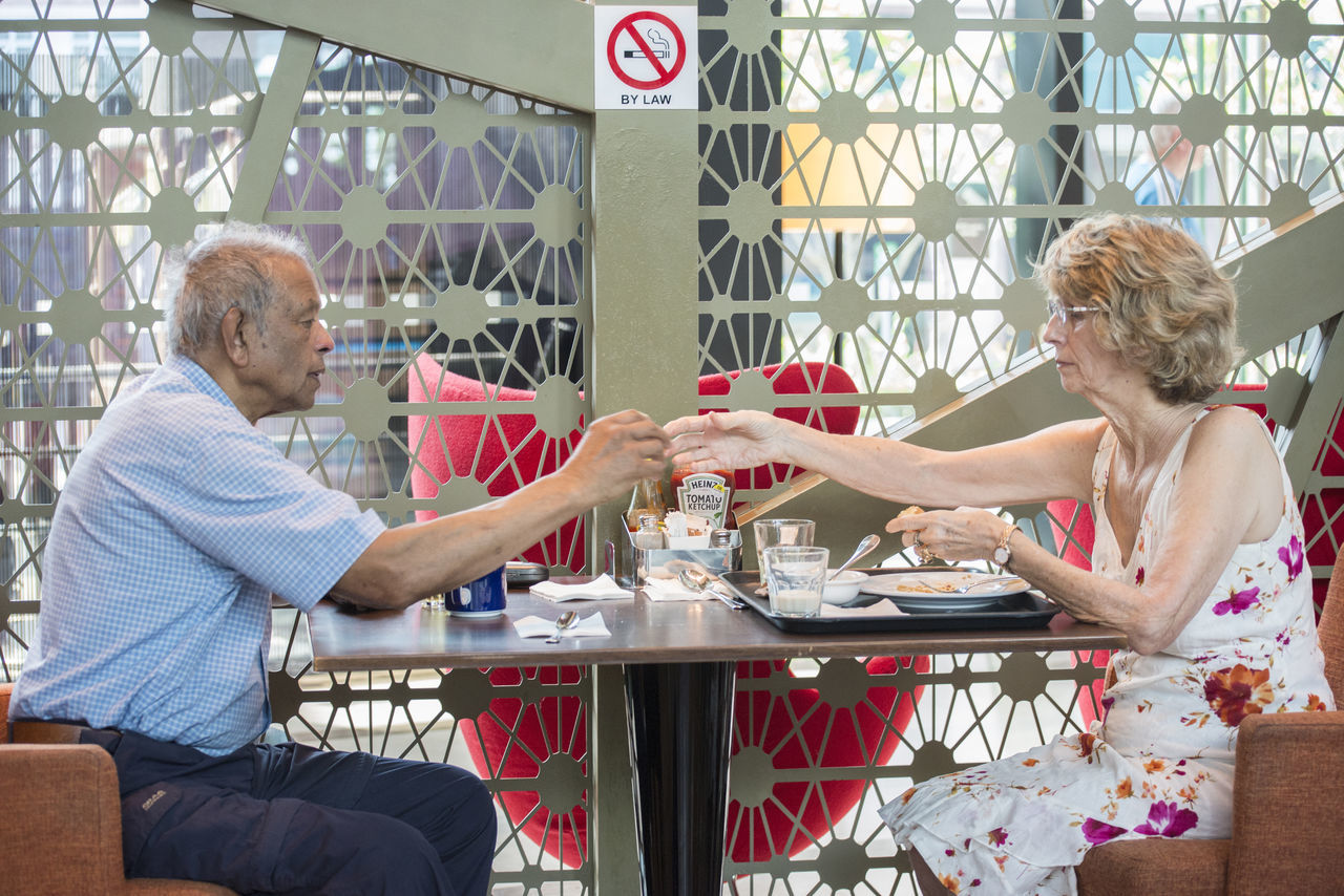 sitting, table, senior adult, cafe, casual clothing, indoors, day, two people, chair, mature adult, customer, togetherness, real people, friendship, men, adult, adults only, people
