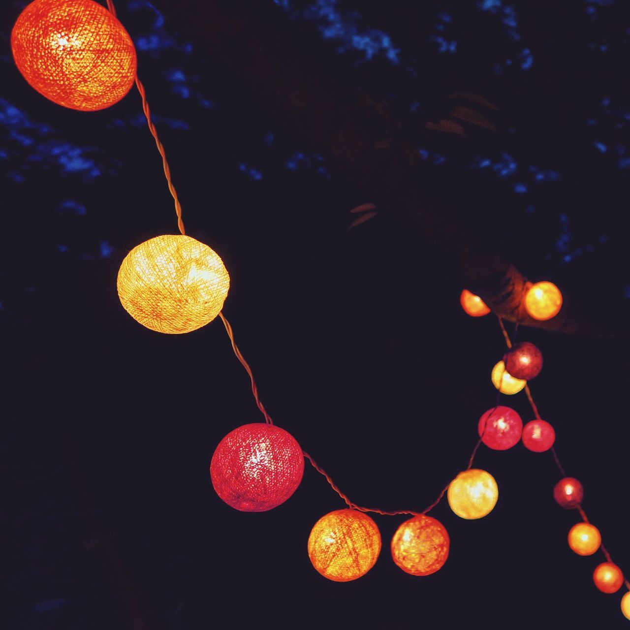 hanging, orange color, no people, tree, yellow, low angle view, citrus fruit, outdoors, night, illuminated, fruit, close-up, nature