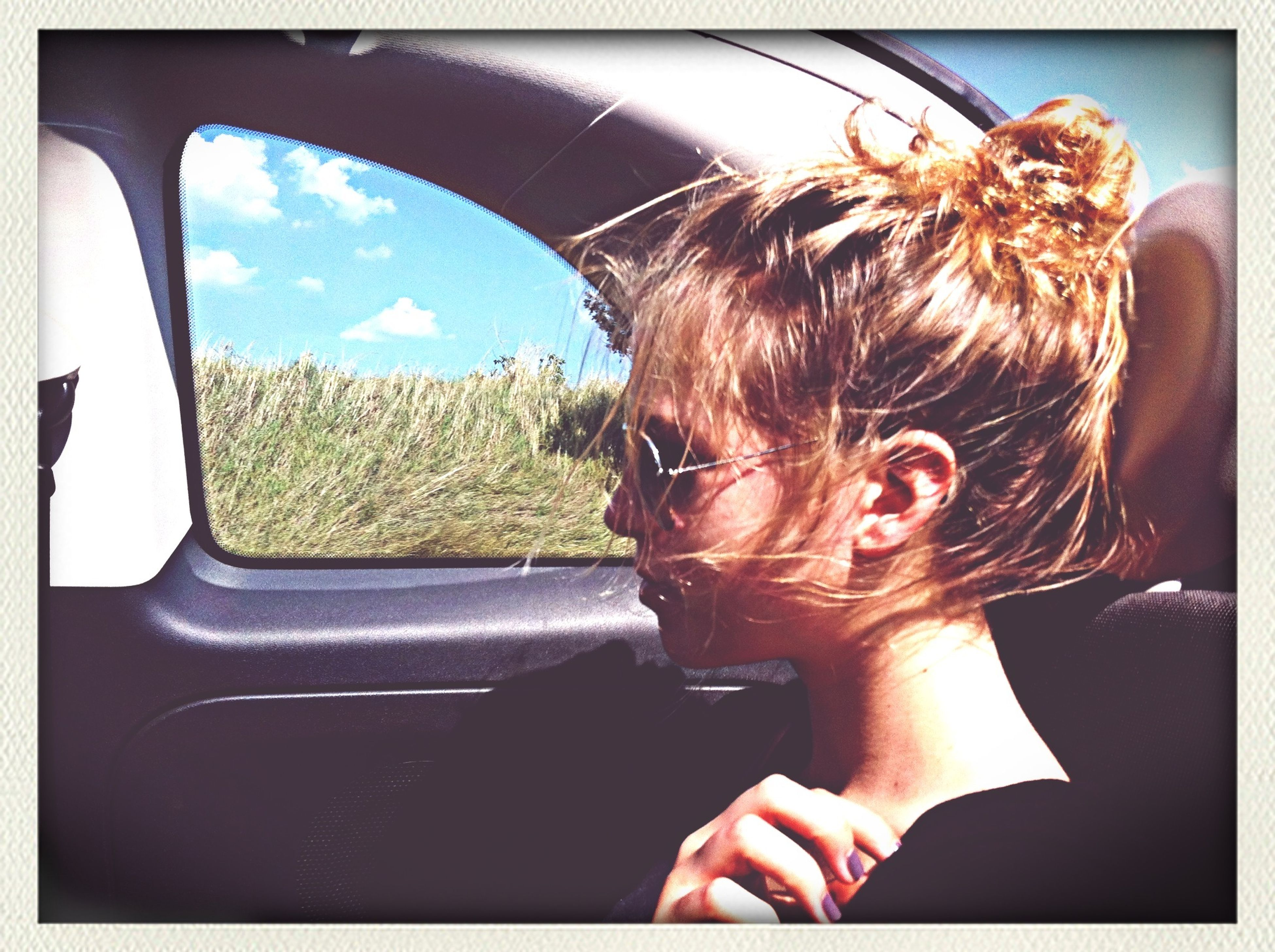 transfer print, auto post production filter, lifestyles, leisure activity, headshot, young adult, sky, sunglasses, young women, head and shoulders, person, window, car, transportation, sunlight, side view, vehicle interior, car interior