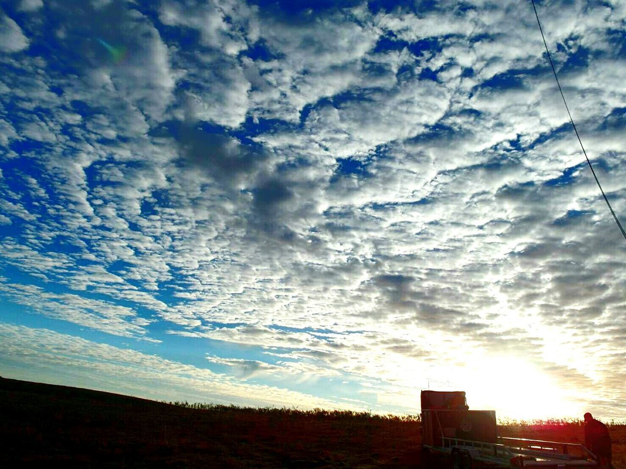 cloud - sky, sky, nature, dramatic sky, no people, beauty in nature, outdoors, scenics, built structure, silhouette, tranquility, building exterior, architecture, sunset, day