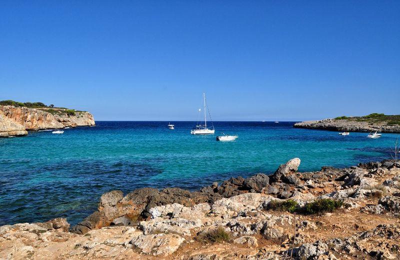 EyeEm Selects cala varques on mallorca balearic island in spain Nautical Vessel Yacht Beach Sea Sailboat Vacations Sunny Travel Destinations Tourism Scenics Sailing Cliff Island Majorca Mallorca Mediterranean  Idyllic Cala Varques