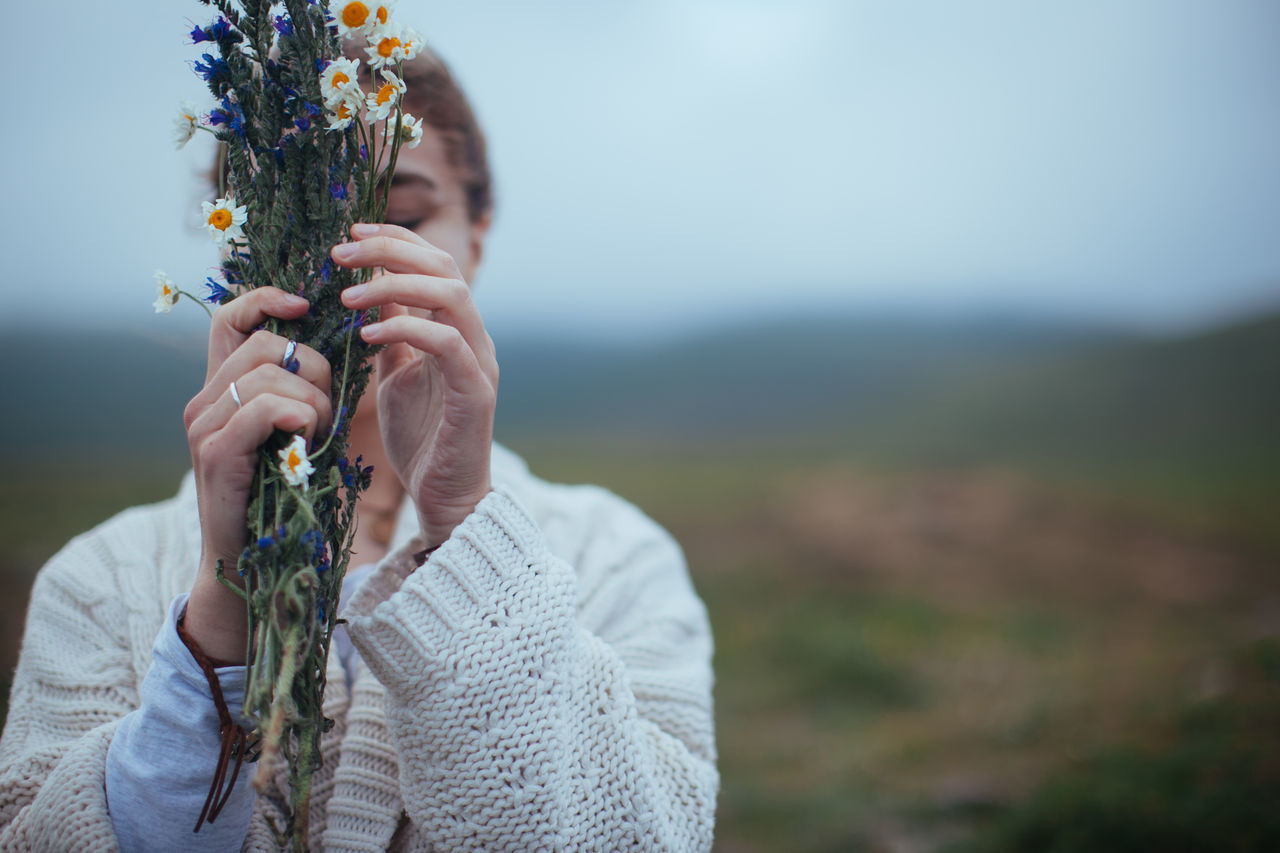 Female Fingers Flowers Holding Mountains