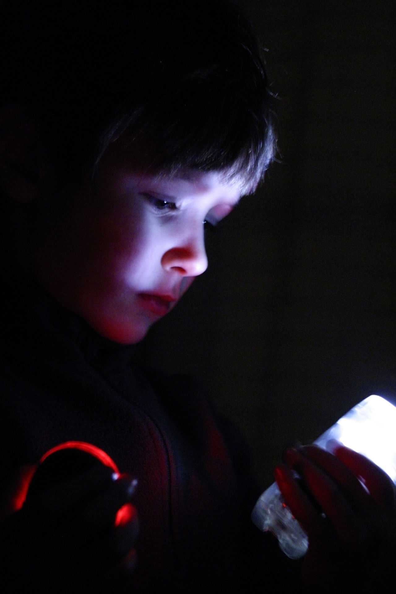 Bicycle Lights Black Background Boy Child Childhood Close-up Curiosity Face Growth Headshot Learning Light Low Light One Person People Portrait Profile Real People Science Wonder
