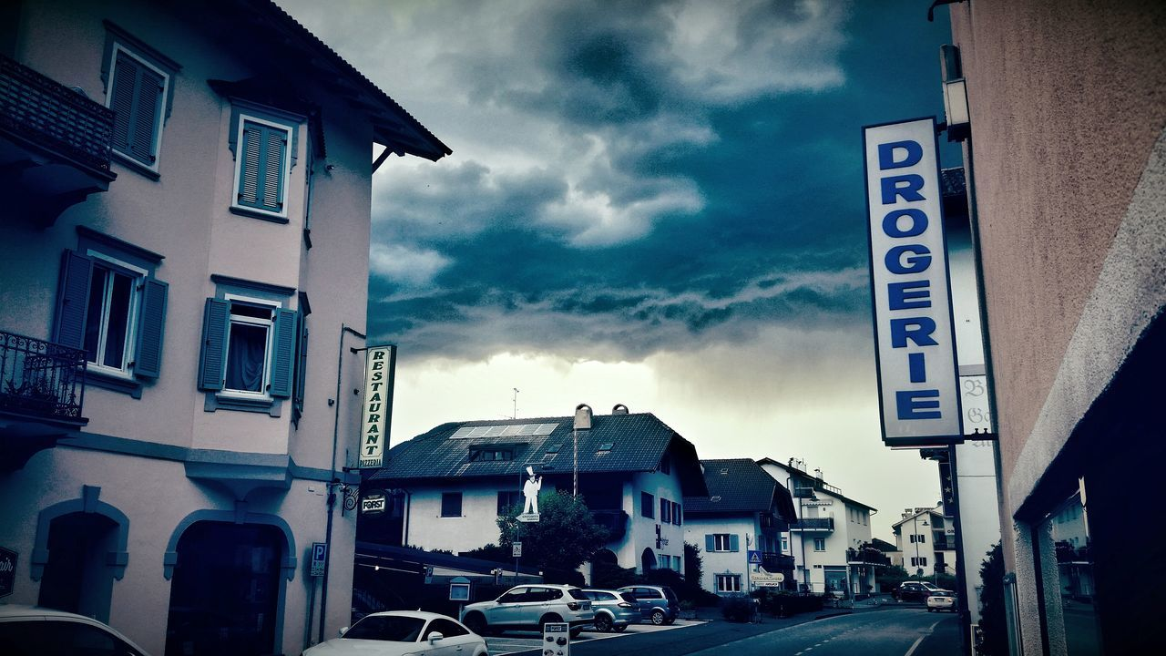 Drogerie Night City City Life Street Streetphotography Rain Rainy Days Car Parking Old House Wolken Sky House Houses Black Drama Dramatic The Essence Of Summer Good Time Restaurant Barbershop Südtirol