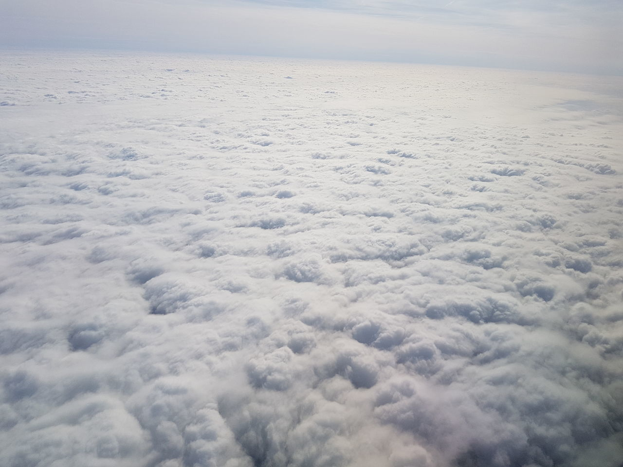 cloud - sky, nature, cloudscape, weather, sky, beauty in nature, tranquility, no people, outdoors, day, backgrounds, scenics, aerial view, flying, airplane