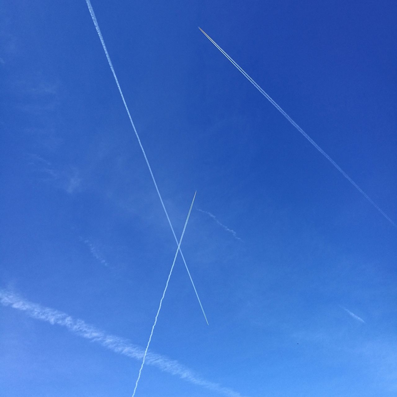 Blue Vapor Trail No People Mid-air Airplane Airshow Low Angle View Day Sky Nature Outdoors Close-up Contrail