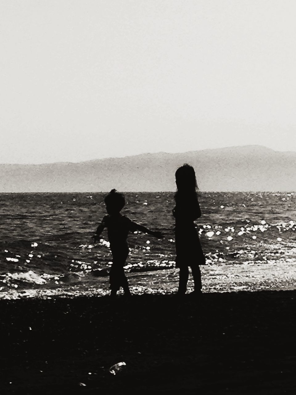 Silhouette Children On Beach