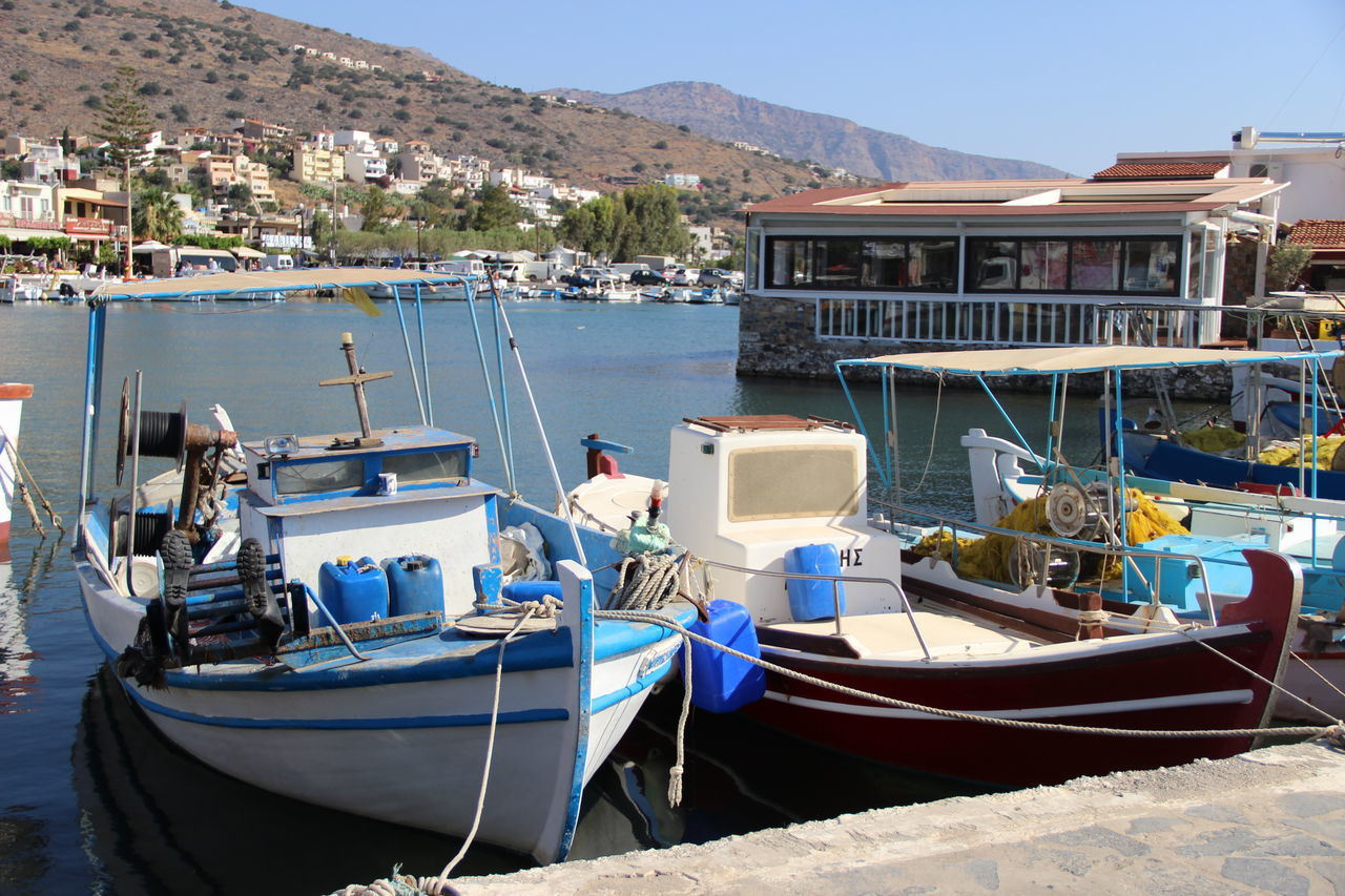 Crete Greece Crete Island Architecture Beauty In Nature Boat Building Exterior Built Structure Clear Sky Crete Crete Heraklion Creteisland Day Harbor Mode Of Transport Moored Mountain Nature Nautical Vessel No People Outdoors Sea Sky Transportation Water Waterfront