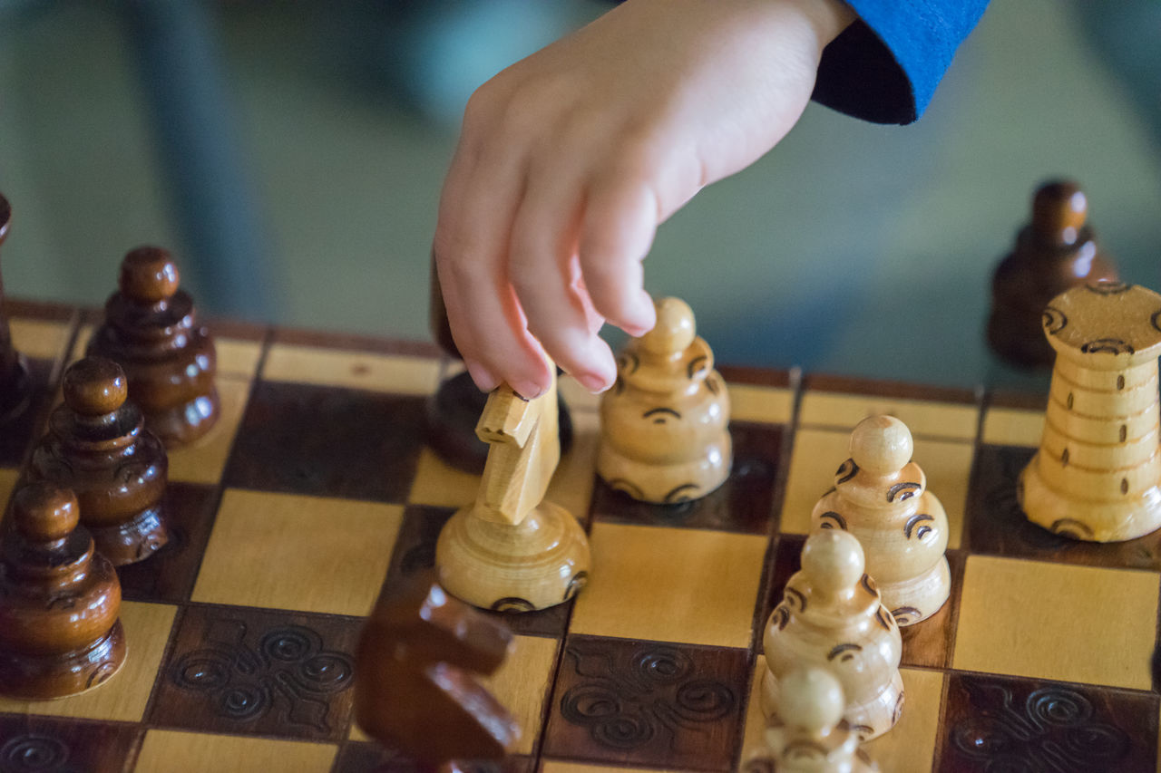 Board Game Boy Chess Chess Board Chess Piece Child Close-up Day Having Fun Human Body Part Human Finger Human Hand Indoors  Kid Knight - Chess Piece Leisure Activity Leisure Games One Person People Playing Queen - Chess Piece Real People Strategy Strong Table