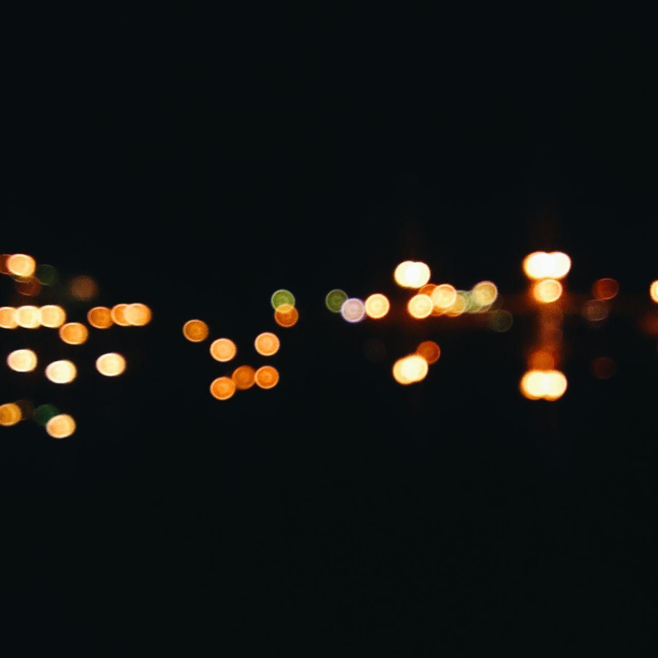 illuminated, night, defocused, no people, outdoors, black background, sky
