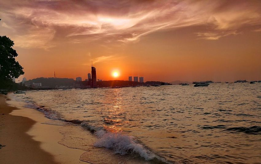 Tonights sunset in pattaya citty Thailand Citty Sunset Thailand Huawei Photography Beautiful Beautiful Sunset EyeEm Selects Eye4photography  2017 Trending Now Sunset Sand Beach Dramatic Sky Environment No People Outdoors Silhouette Sky Sea Sun City Travel Destinations Nature Landscape Cloud - Sky Skyscraper
