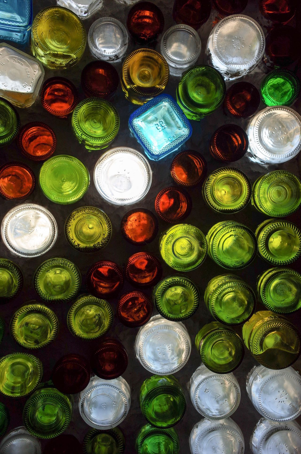 Colorful Bottles Building a Wall. Large Group Of Objects Abundance Multi Colored Variation No People Backgrounds Choice Full Frame Indoors  Day Close-up Freshness Structure Light And Shadow Indoor Photography Bottle Wall Textured