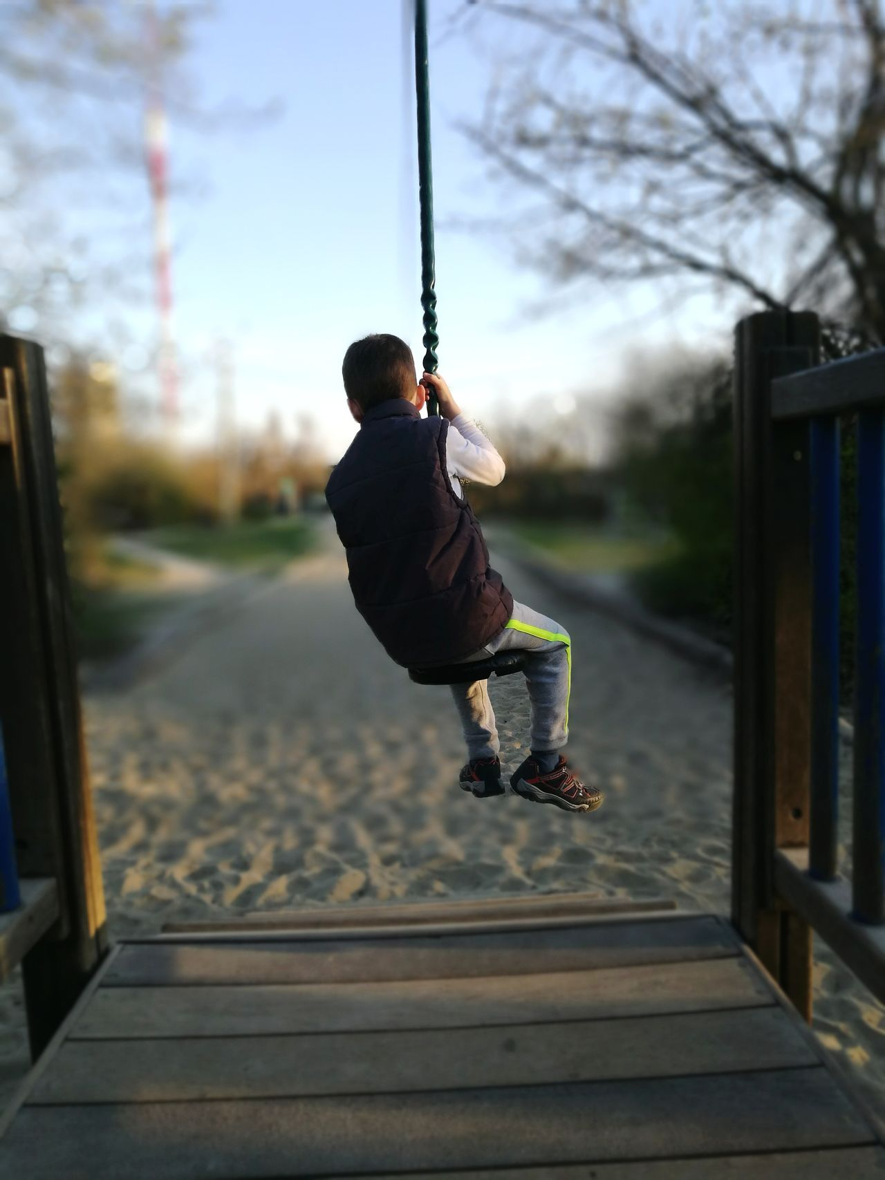 Full Length One Person Childhood Swing Motion People Fun Child Sky Outdoors Gripping Playground Jumping Sport Day Human Body Part Childhood Memories EyeEmNewHere The Great Outdoors - 2017 EyeEm Awards