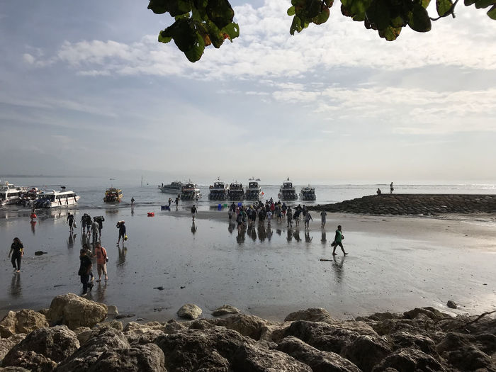 Bali, Indonesia Beach Cloud - Sky Day Horizon Over Water Large Group Of People Leisure Activity Lifestyles Men Nature Outdoors People Real People Scenics Sea Sky Water Women