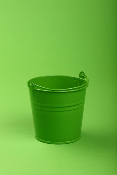 Green empty small metal painted bucket over greenery paper background Bucket Close-up Colored Background Copy Space Eco Ecology Empty Enviorment Freshness Green Green Background Green Color Greenery Healthy Healthy Eating High Angle View Natural No People Studio Shot Tin Vegetarian Wastepaper Basket
