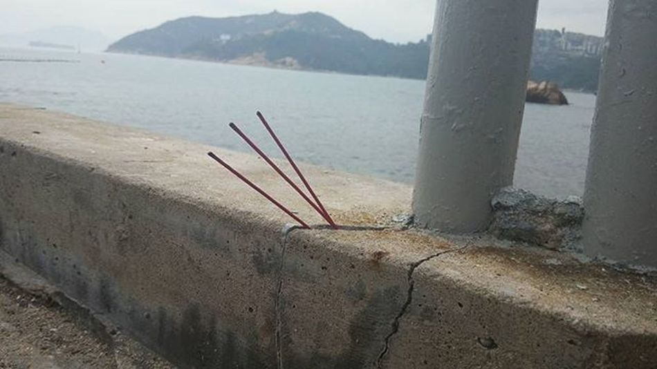 Someone's offering in hopes of a good catch before they cast their line. Jossstick Offeringstothegods HongKong Crack