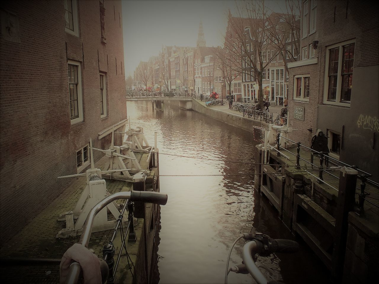 architecture, building exterior, built structure, mode of transport, transportation, water, bicycle, outdoors, nautical vessel, city, day, one person, people