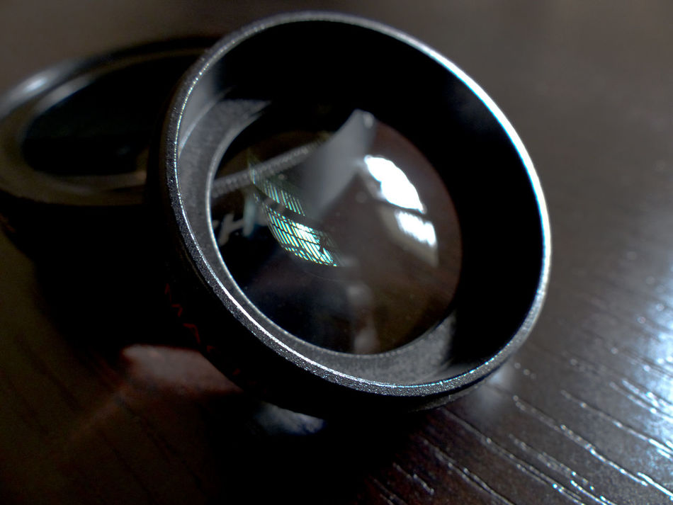 Close-up of a camera phone add on lens fro wide angle shots. Window reflecting in the galss Camera - Photographic Equipment Camera Phone Close-up Glass Glass Lens  Lens Flare Metal No People Reflection Technology