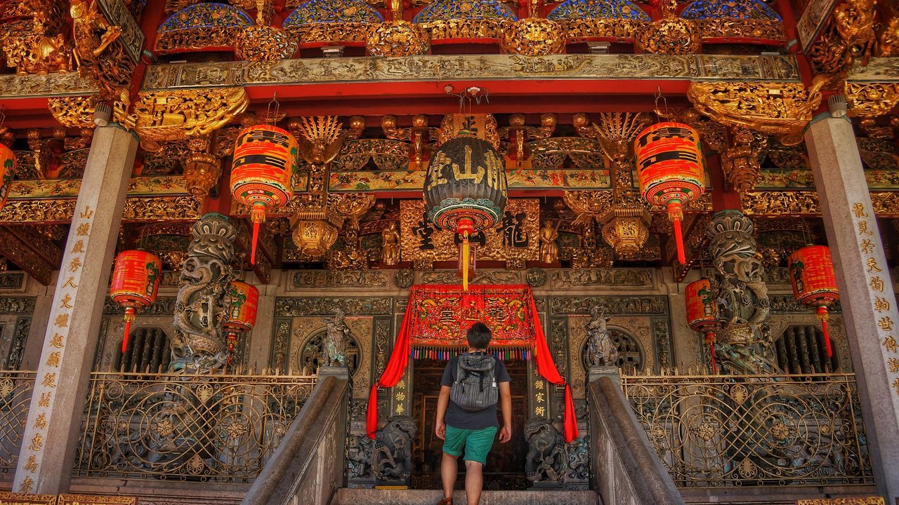 Entering the ancient Khoo Kongsi Asian  Asian Culture Georgetown Penang Khoo Kongsi Adult Altar Architecture Building Exterior Built Structure Day Full Length History Indoors  Malaysia One Person People Petal Place Of Worship Real People Religion Spirituality Statue Tourism Travel Travel Destinations