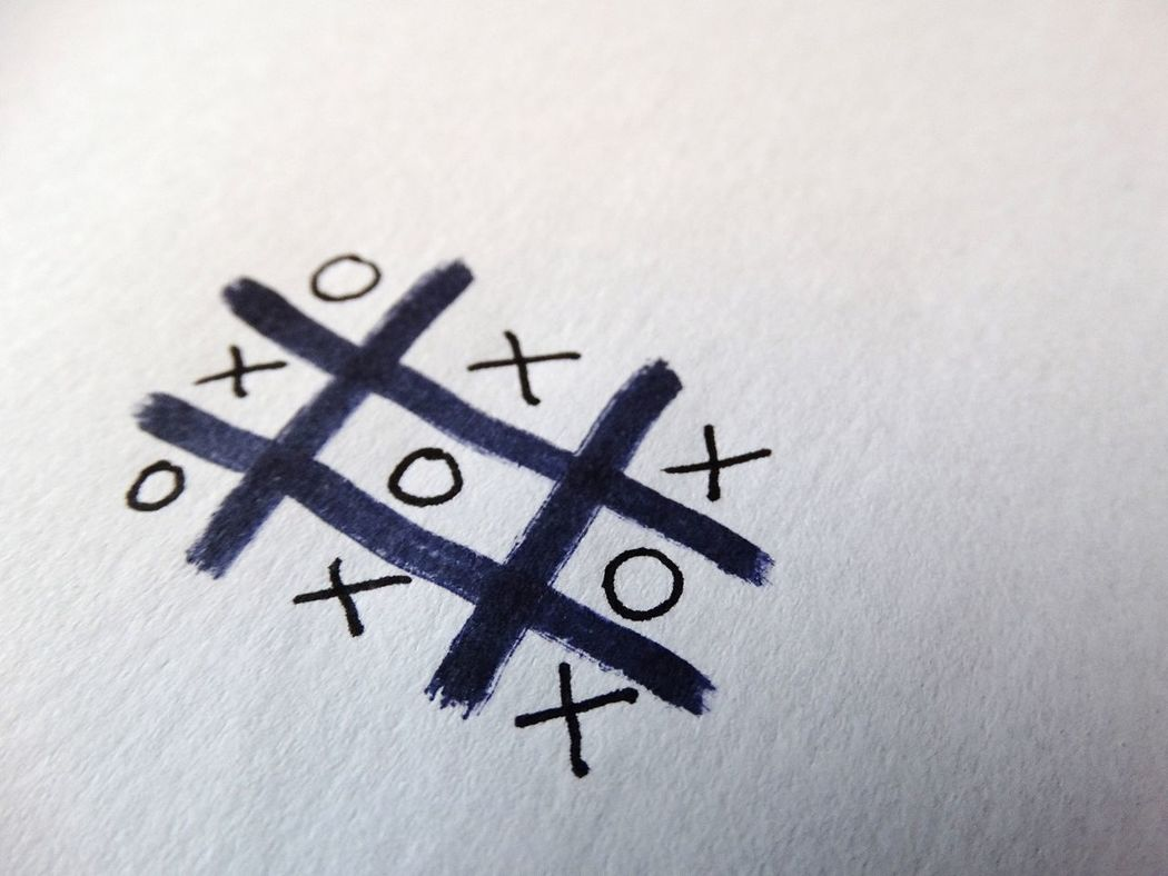 Noughts and Crosses game on paper. Paper Game Games Noughts And Crosses Noughtsandcrosses Tic Tac Toe Paper Games Drawing Ink Black Ink Marker Pen Markings Symbols Fun Bored Symbol White Background Draw Scribble Tictactoe Stalemate