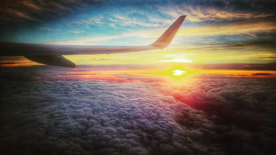 Sunrise Above The Clouds From The Plane Window Boeing737800 Norwegian Air Shuttle
