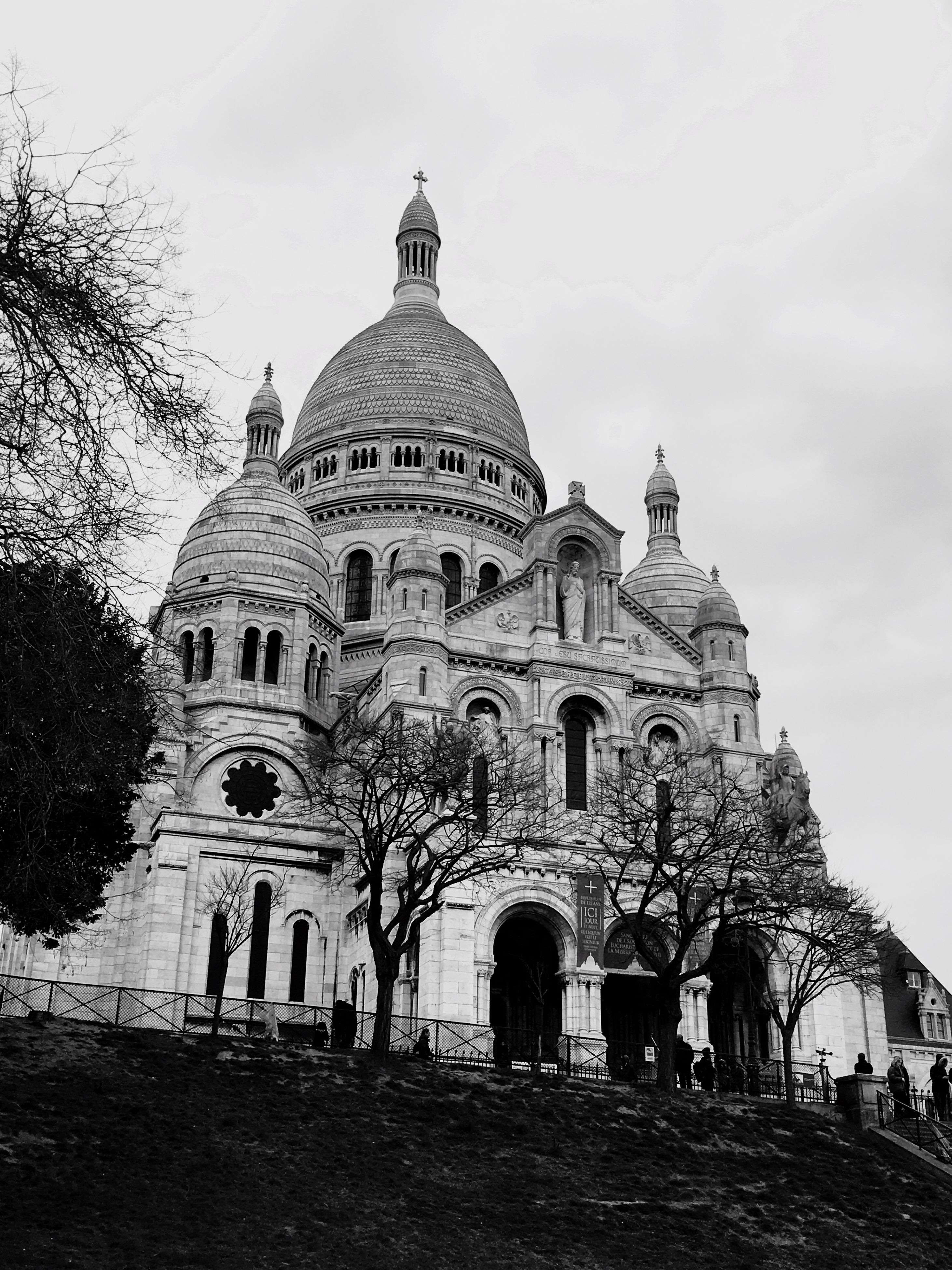 place of worship, religion, architecture, building exterior, spirituality, built structure, church, dome, cathedral, sky, history, famous place, facade, cross, travel destinations, arch, tourism, low angle view