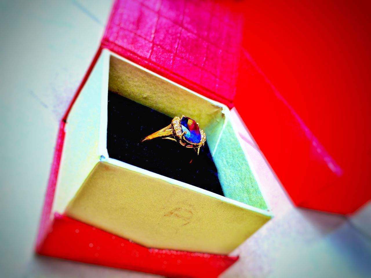 High Angle View Of Gold Ring In Jewelry Box On Table