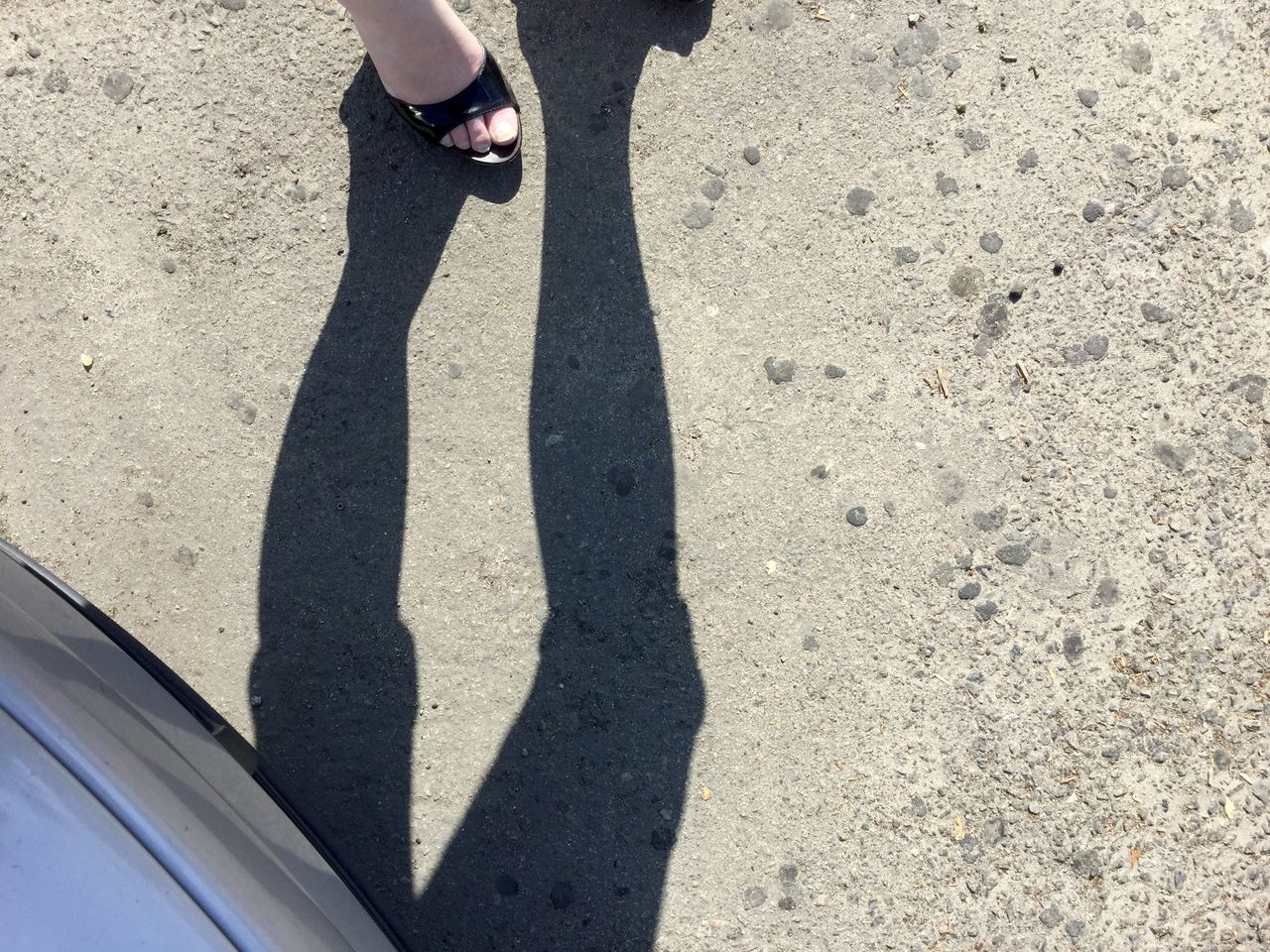 shadow, real people, low section, one person, lifestyles, sunlight, human leg, standing, day, high angle view, leisure activity, human body part, car, women, outdoors, human hand, adult, people