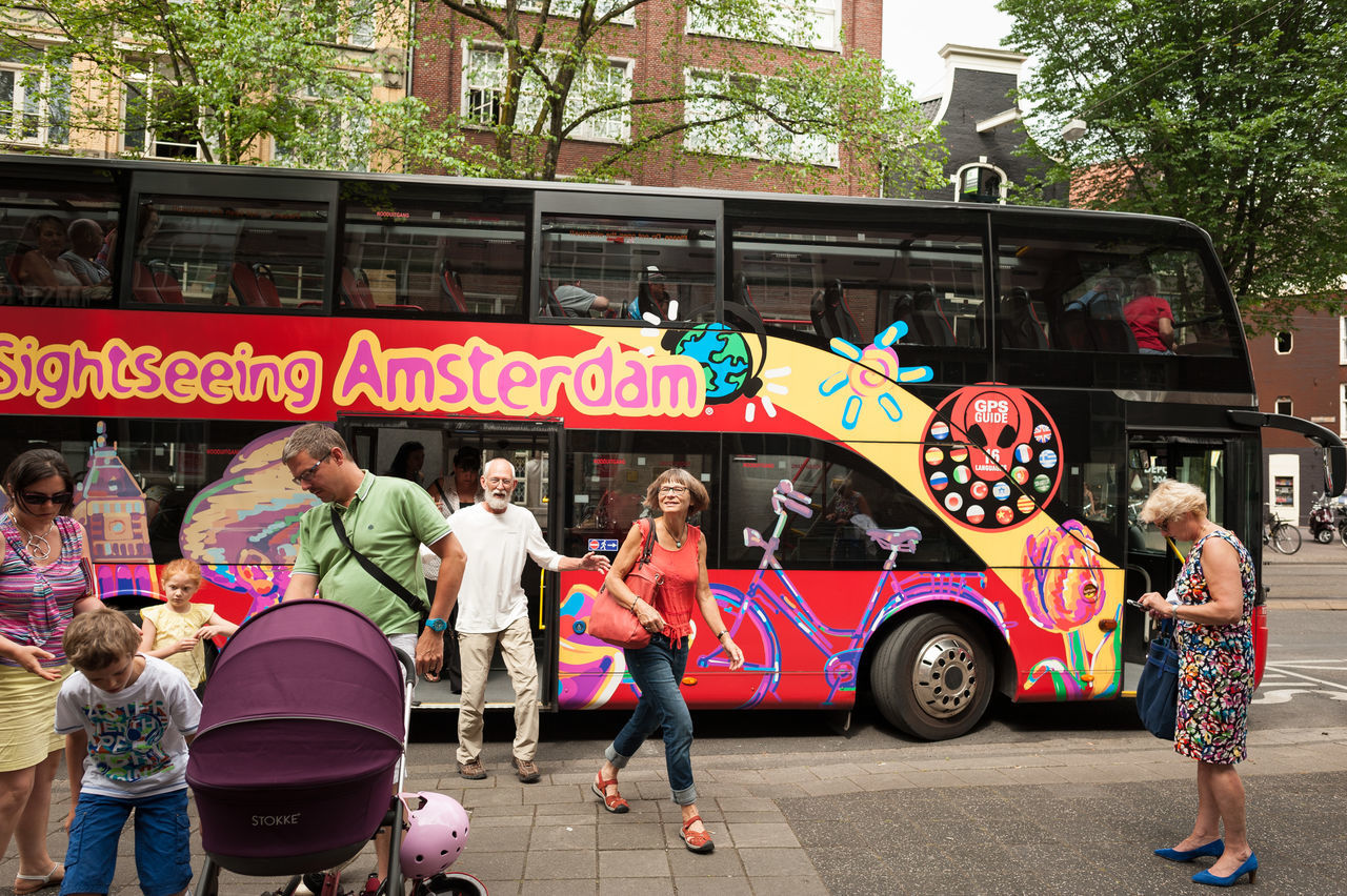 Amsterdam Car Choice City Life Composition Culture Cultures Incidental People Land Vehicle Large Group Of Objects Men Mode Of Transport Occupation Older Couple Perspective Real People Retail  Store Street The Tourist Togetherness Tour Bus Transportation Variation Women