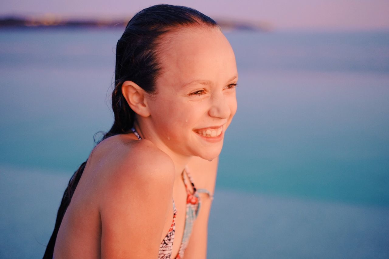 Portrait Of Beautiful Young Woman At Beach