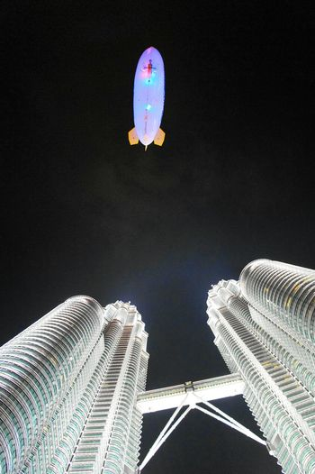 The Architect - 2016 EyeEm Awards Envision The Future A Blimp and the Twins. A small blimp flying around the Petronas Twin Towers in Kuala Lumur. Kuala Lumpur Kualalumpur Malaysia EyeEm Malaysia Petronas Twin Towers Klcc Kuala Lumpur City Center Twin Towers Kuala Lumpur Twin Towers Night Blimp Airship Aviation Architecture Cityscapes Flying Wanderlust Gettylicious Newstrekker Architecture_collection EyeEm Best Shots Travel Photography Twins