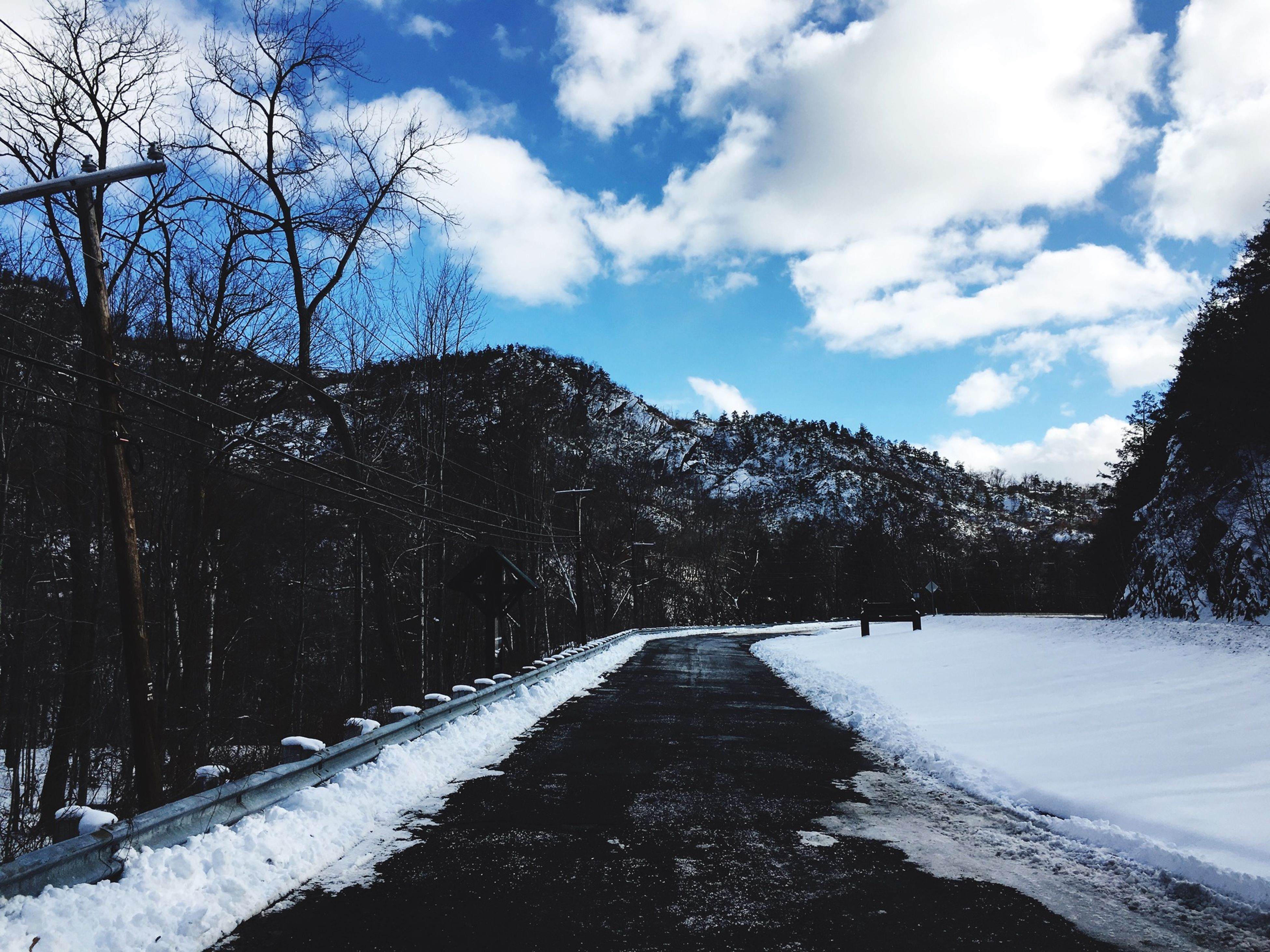 snow, winter, cold temperature, the way forward, sky, diminishing perspective, season, tree, vanishing point, weather, tranquility, tranquil scene, road, covering, mountain, nature, cloud - sky, bare tree, beauty in nature, scenics