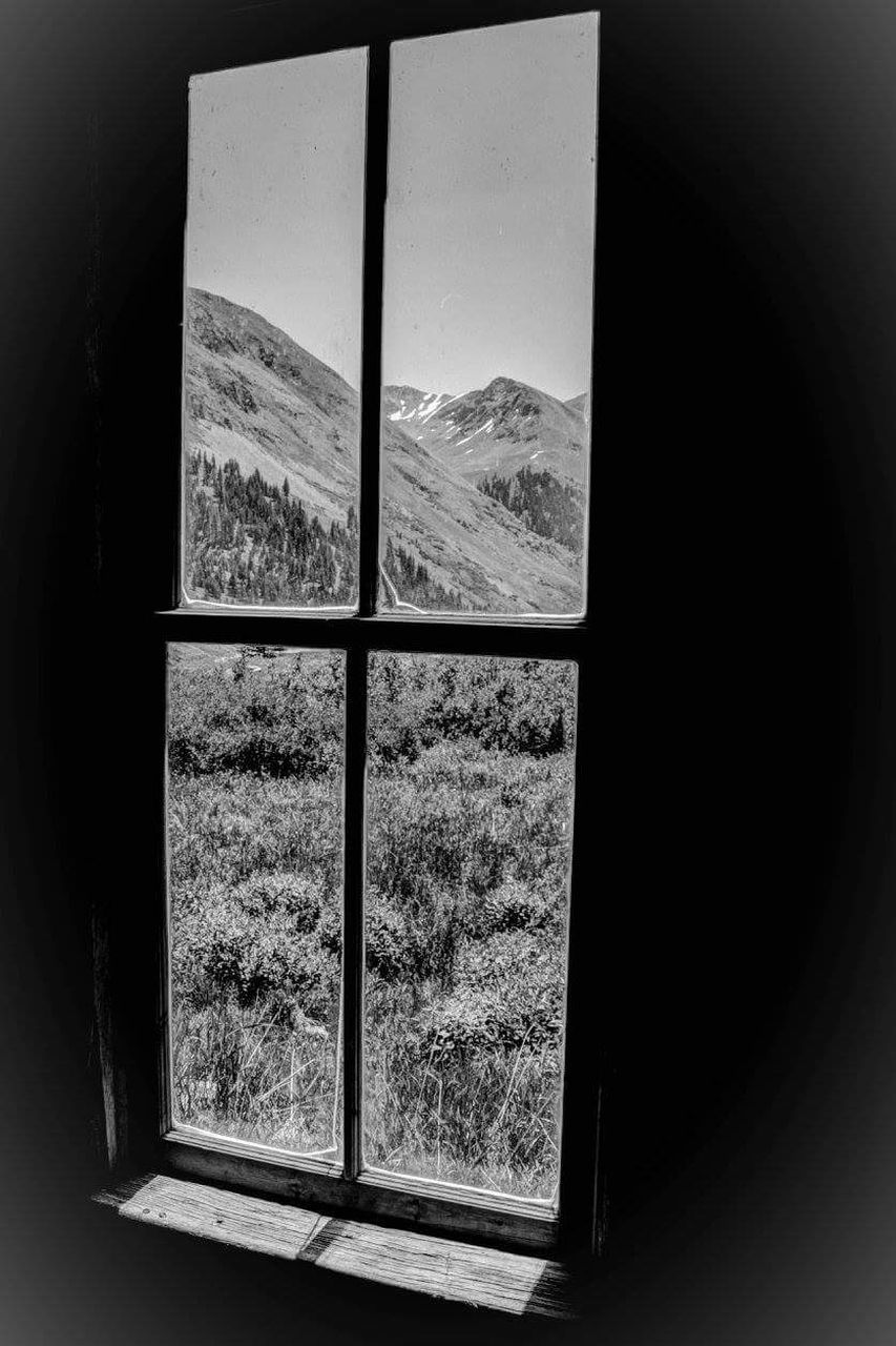 window, mountain, indoors, looking through window, no people, day, landscape, mountain range, nature, scenics, tree, sky