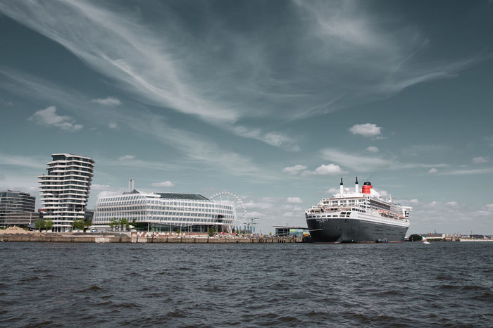 Architecture Blue Built Structure City Cloud Cloud - Sky Cloudy Cruise Cruise Liner Cruise Ship Cunard Day Germany Hamburg Nature No People Outdoors Queen Mary 2 Queen Mary II Rippled Sky Travel Destinations Water Waterfront People Of The Oceans