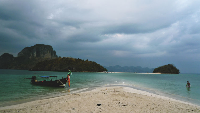 Travel fever Beach Beauty In Nature Boat Cloud Cloud - Sky Cloudy Dramatic Sky Horizon Over Water Mode Of Transport Moody Mountain Nature Nautical Vessel Sand Scenics Sea Shore Sky Thailand Tranquil Scene Tranquility Transportation Travel Photography Water Spotted In Thailand
