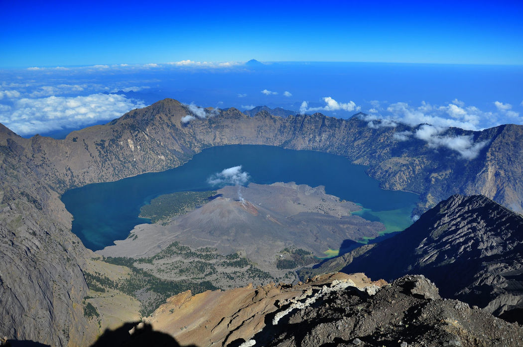 top view segara anak lake from Mt.Rinjani altitude 3726m above sea level Lombok NTB. Beauty In Nature Blue Dramatic Landscape Idyllic INDONESIA Landscape Lombok Majestic Mataram Mountain Mountain Range Mt.Rinjani Nature Non-urban Scene NTB Physical Geography Segaraanak Snowcapped Mountain Tourism Tranquil Scene Tranquility Travel Travel Destinations Volcanic Crater Water The Great Outdoors - 2017 EyeEm Awards