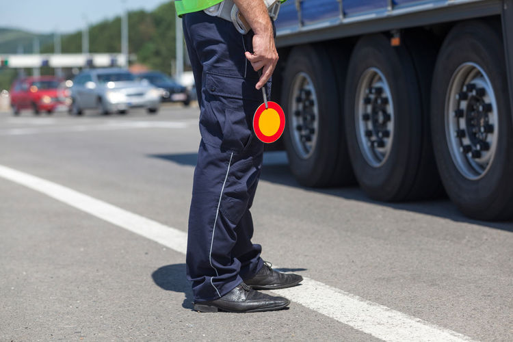 Police officer doing a traffic control Law Enforcement Uniform Driver Police Officer Policeman Car Highway Police Police Control Safety Security Staff Surveillance Traffic Control Traffic Speed Control Truck Vehicle