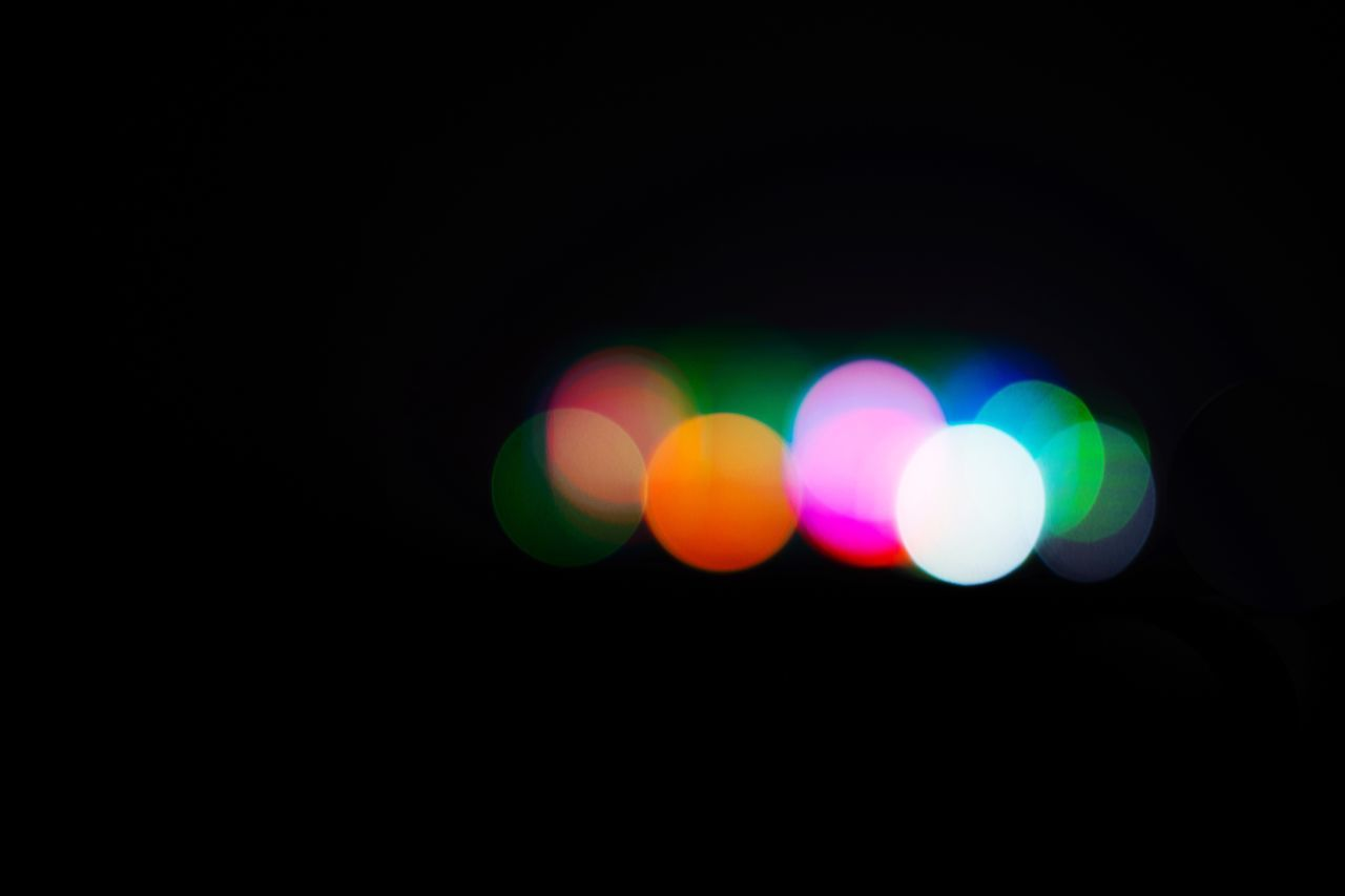 night, illuminated, copy space, colorful, light effect, defocused, dark, no people, multi colored, black background, outdoors, close-up, sky