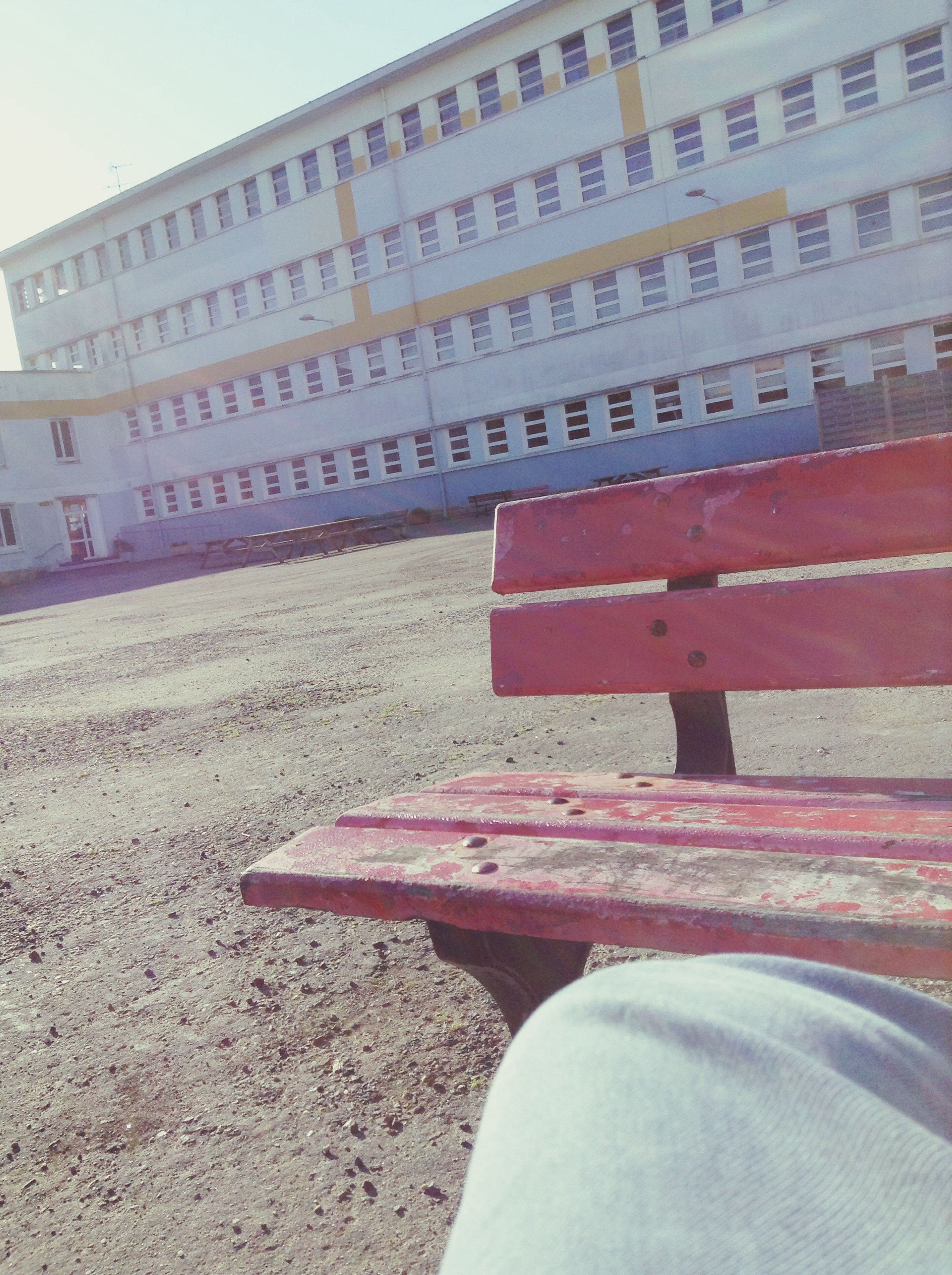 built structure, architecture, building exterior, day, red, outdoors, sky, no people, steps, building, city, sunlight, wall - building feature, bench, close-up, stone material, absence, street, part of, cropped