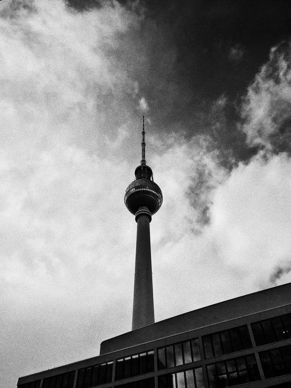 architecture, built structure, building exterior, tall - high, spire, communication, sky, low angle view, television tower, travel destinations, cloud - sky, tower, city, outdoors, no people, tourism, travel, modern, day