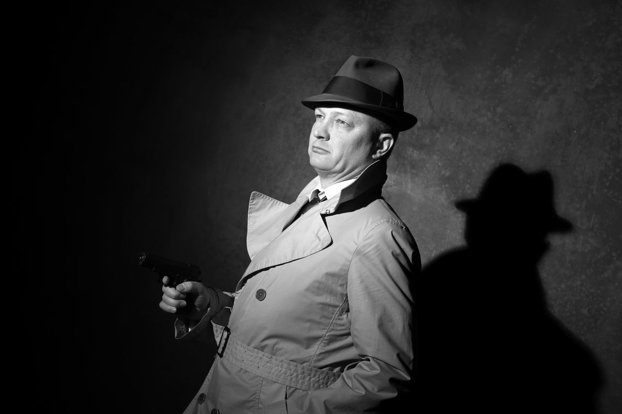 film noir style gangster with fedora and gun 40s Actor Adult Adults Only Agent Blackandwhite Film Industry Film Noir Gangster Gun Hat Killer MOVIE Night Old-fashioned One Man Only One Person Only Men Outdoors People Performing Arts Event Pistol Retro Secret Service Trenchcoat