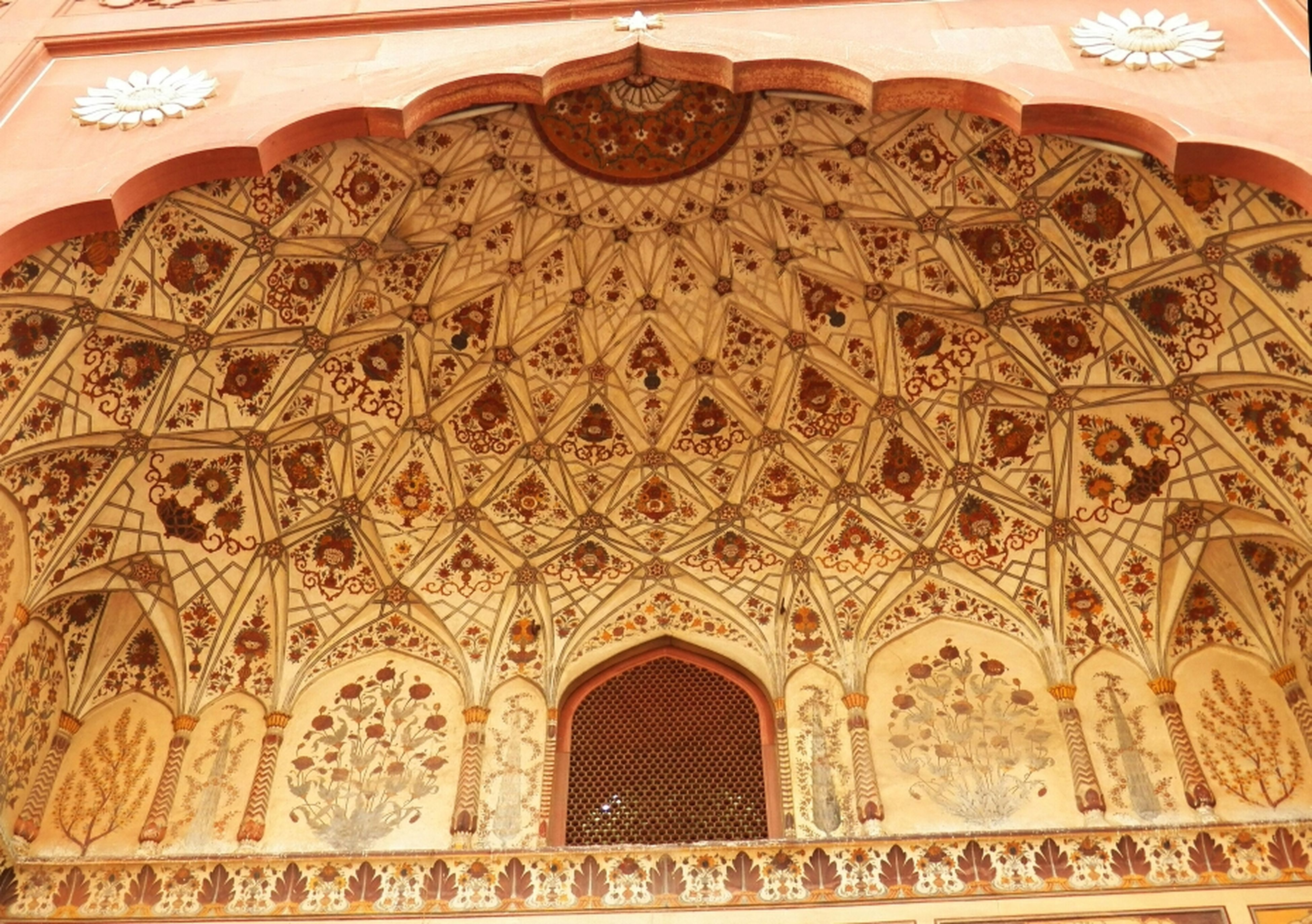 indoors, ornate, low angle view, design, ceiling, architecture, pattern, art and craft, place of worship, religion, built structure, famous place, architectural feature, arch, art, spirituality, creativity, travel destinations, carving - craft product, tourism