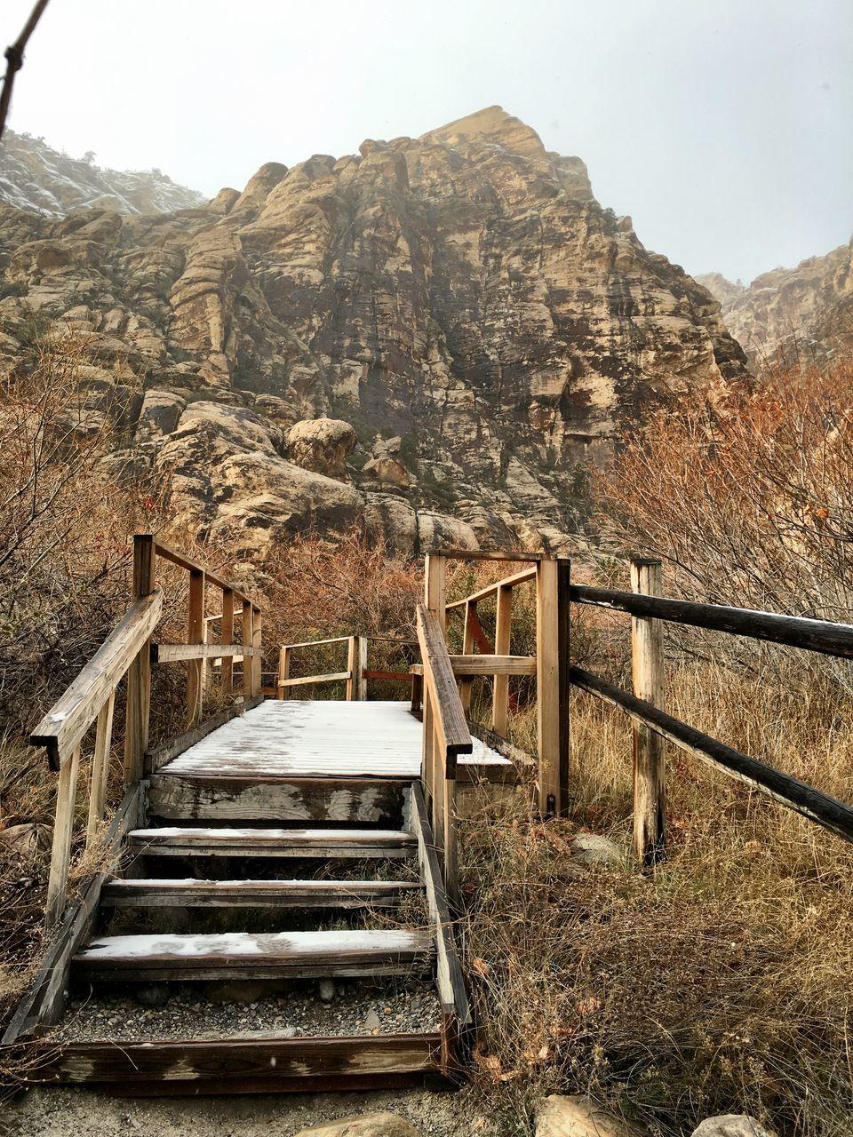 Footbridge Against Rocky Mountains