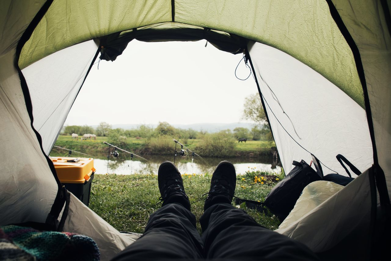 Adventure Camping Close-up Day Fishing Grass Human Body Part Human Foot Human Leg Leisure Activity Lifestyles Low Section Men Nature One Man Only One Person Outdoor Photography Outdoors People Personal Perspective Real People Shoe Tent Tree Vacations
