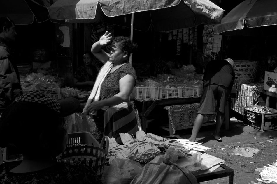 B&w Street Photography Bali Bali, Indonesia Casual Clothing Chasing Harsh Light Chasing Light Day Everybody Street Everydayasia INDONESIA Lifestyles Light And Shadow Monochrome Outdoor Market Pasar People Real People Street Photography Traditional Market Woman Blocking The Sun