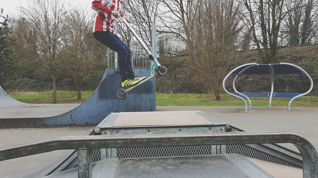 Leisure Activity Tree Lifestyles One Person Day Skateboard Park Jumping Outdoors Real People People Low Section Stunt Getting Some Air Mid Air Flying Scooter Calum My Son Skatepark Tricks Skill  Park - Man Made Space