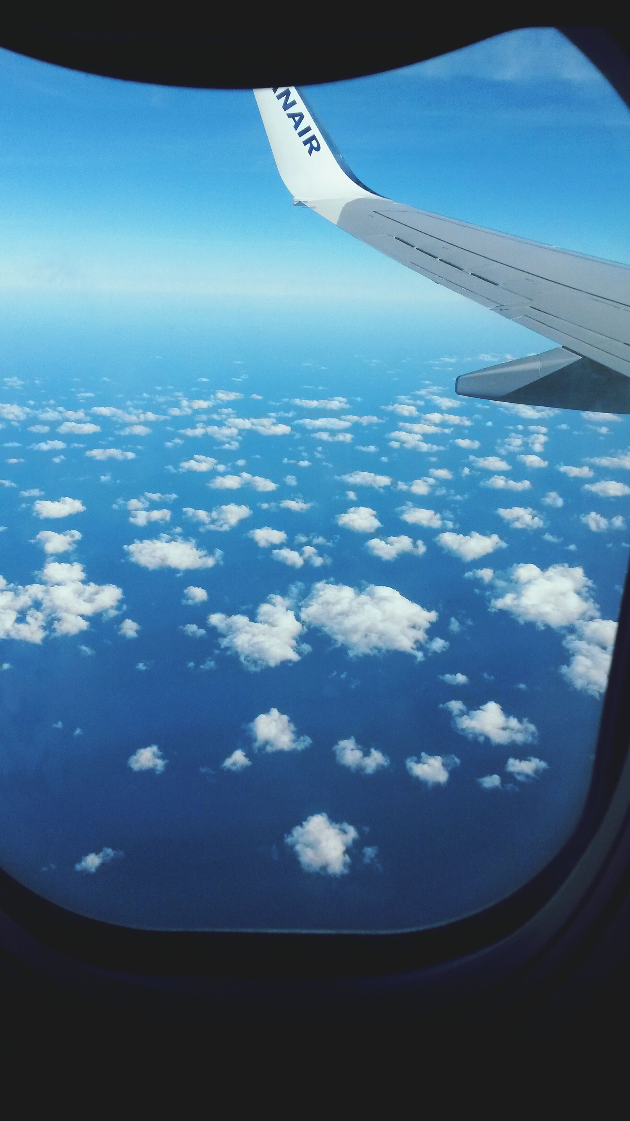 airplane, aerial view, flying, sky, aircraft wing, mid-air, window, air vehicle, scenics, cloud - sky, transportation, nature, vehicle interior, journey, no people, beauty in nature, outdoors, landscape, commercial airplane, day, airplane wing, space, close-up