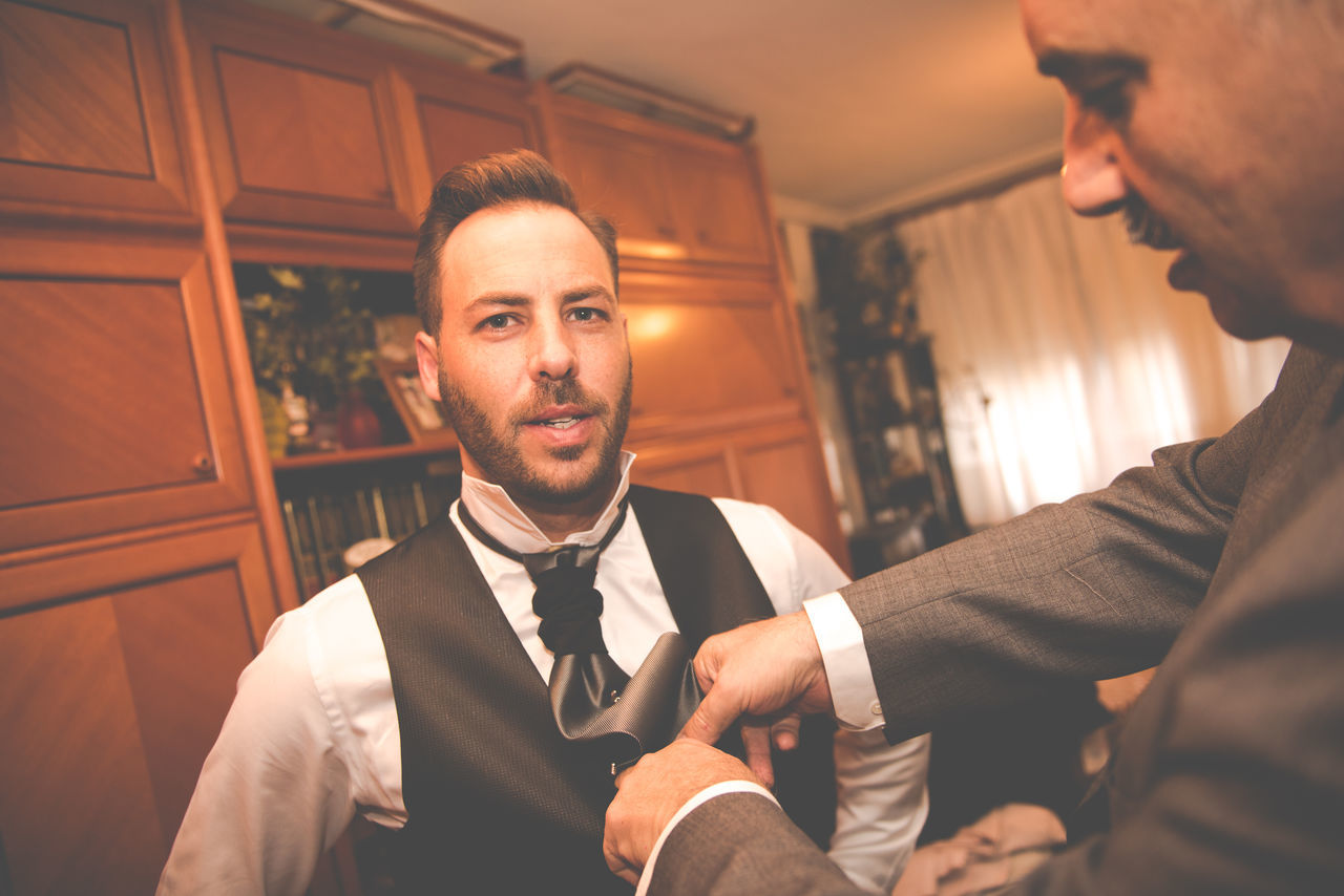 two people, bow tie, togetherness, well-dressed, indoors, men, suit, love, young men, real people, young adult, standing, bridegroom, human hand, day, close-up, people