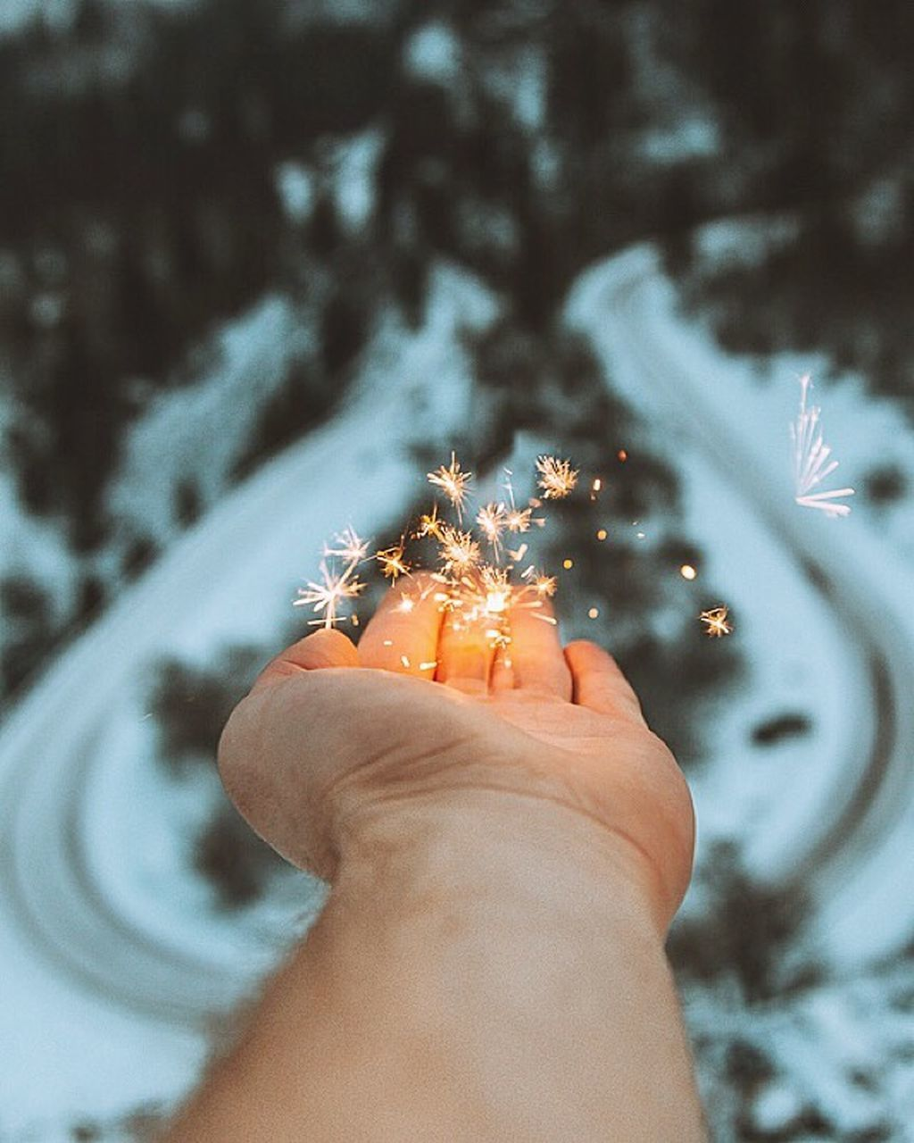 human hand, human body part, real people, one person, christmas decoration, holding, illuminated, personal perspective, tree, christmas, lifestyles, focus on foreground, sparkler, leisure activity, christmas tree, celebration, outdoors, close-up, night, snow, nature, snowflake, people