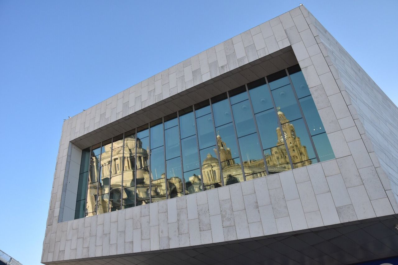 Architectural reflections. My Year My View Architecture Building Exterior Built Structure Low Angle View Clear Sky Blue No People Day EyeEm Best Shots Outdoors City Urban Reflections Building Reflections Eye4photography  Reflections Architecture Getty X EyeEm Sky EyeEm Gallery Old Buildings EyeEm Modern Architecture EyeEm Masterclass in Liverpool